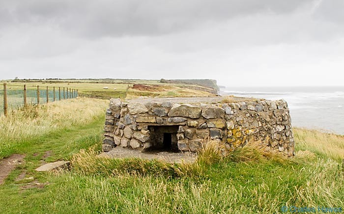 Pill box on the Wales Coast path near Tressilian Bay photographed by Charles hawes. Walking in Wales.