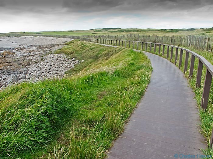 Broadwalk by the Goldf course photographed from the Wales Coast Path by Charles hawes. Walking in Wales.