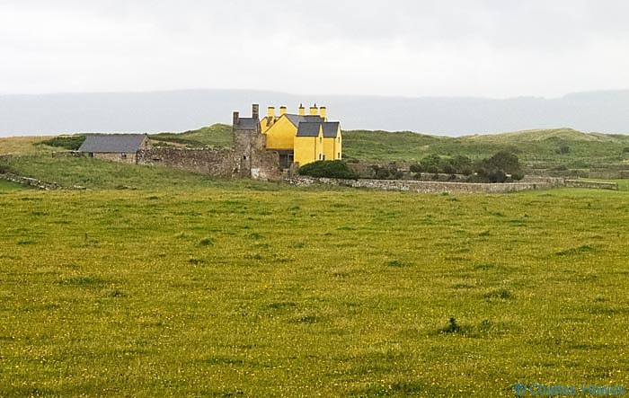 View to Sker House photographed from the wales Coast path by Charles Hawes. Walking in Wales.