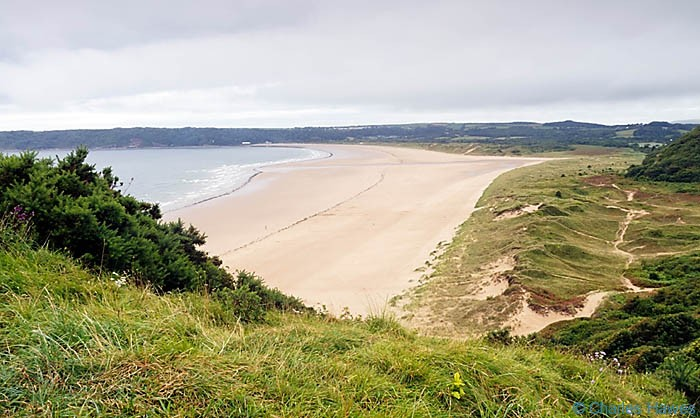 View over Oxwich Bay on the Wales Coast Path between Pennard Burrows and Rhossili photographed by Charles Hawes. Walking in Wales.