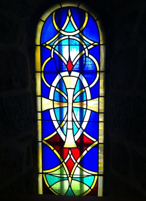 Stained glass window in the Chapelle Saint Roch on The way of St James, France, photographed by Charles Hawes. Route St Jacques. GR65