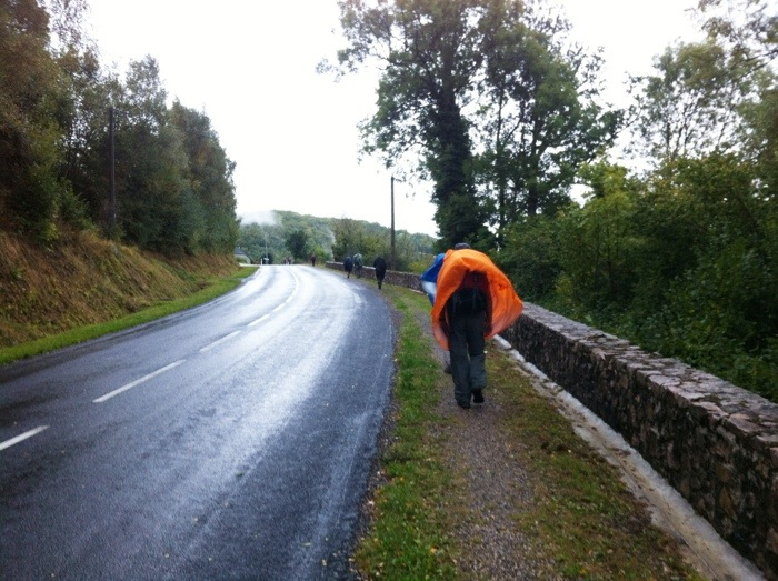Setting off in the rain on The Way of St James between Chel D'Aubrac and St. Come d'Olt photographed by Charles Hawes. Route St jacques. GR65