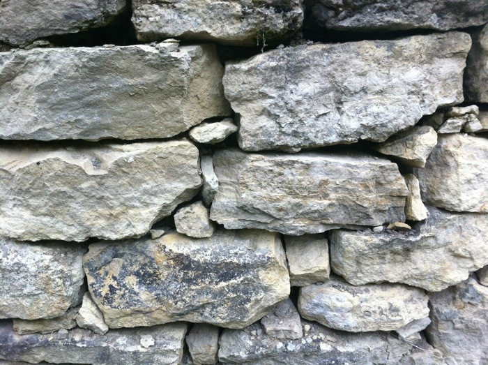 Limestone walls on on The Way of St James between Chely D'Aubrac and St. Come d'Olt photographed by Charles Hawes. Route St jacques. GR65