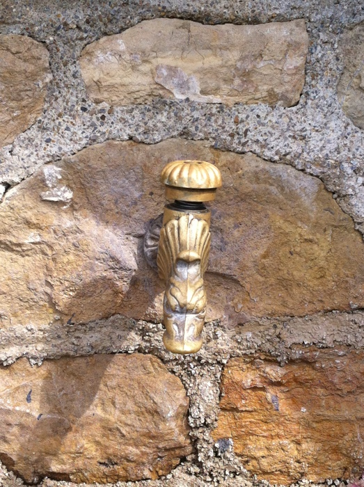 Water tap at Tredou church, Walking The Way of St James between St Come D'Olt and Estaing written and photographed by Charles Hawes. Route St Jacques.