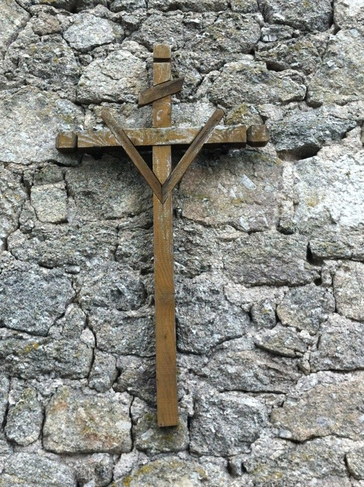 One of the many crosses on The way of St James, France, photographed by Charles Hawes between Estaing and Golinhac