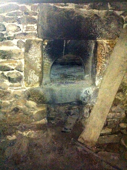 Bread oven in abandoned bakery on The way of St James in France bewtween Estaing and Golinhac, photographed by Charles Hawes. Walking in France.