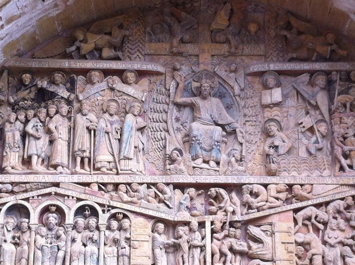 Detail of tympanum above entrance to Conques Catherdal, France, on The Way of St James, photographed by Charles Hawes