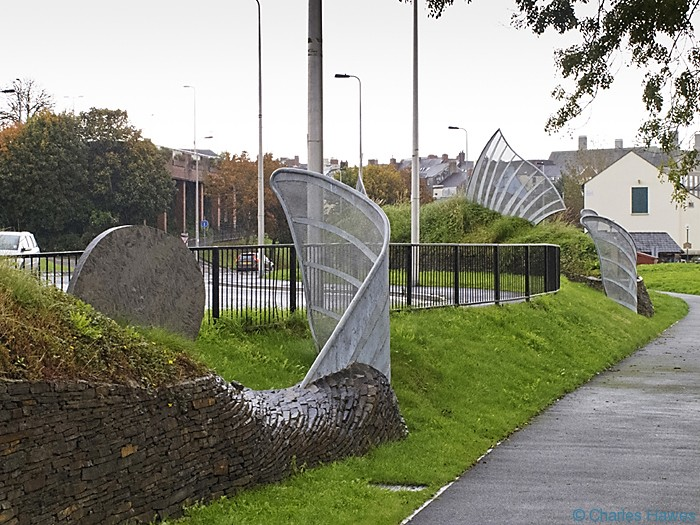 Art installation by the road in Carmarthen on The wales Coast path and photographed by Charles Hawes. Walking in Wales.
