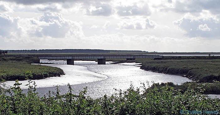 Railway bridge across the River Gwendraeth, photographed from The Wales Coast Path by Charles Hawes. Walking in Wales.