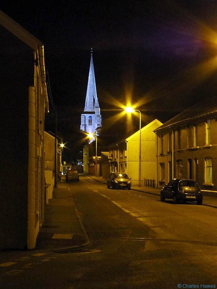 St Mary's Church Kidwelly at night, photographed by Charles Hawes. Walking in Wales.