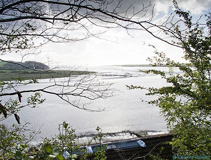 The estuaury near Laugharne photographed from the Wales Coast Path between St Clears and Amroth by Charles Hawes. Walking in Wales.