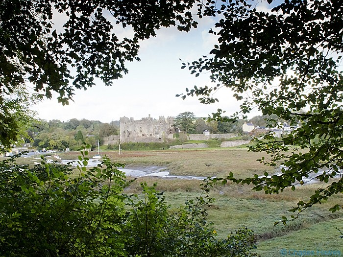 View of Laugharne castle photographed from the Wales Coast Path between St Clears and Amroth by Charles Hawes. Walking in Wales.