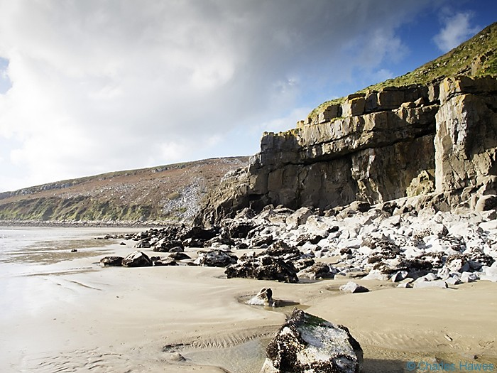 Cliffs near Pendine photographed from the Wales Coast Path between St Clears and Amroth by Charles Hawes. Walking in Wales.