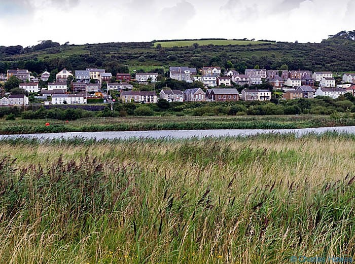 View to Pwll photographed on The Wales Coast path between Llanelli and Kidwelly by Charles Hawes. Walking in Wales.