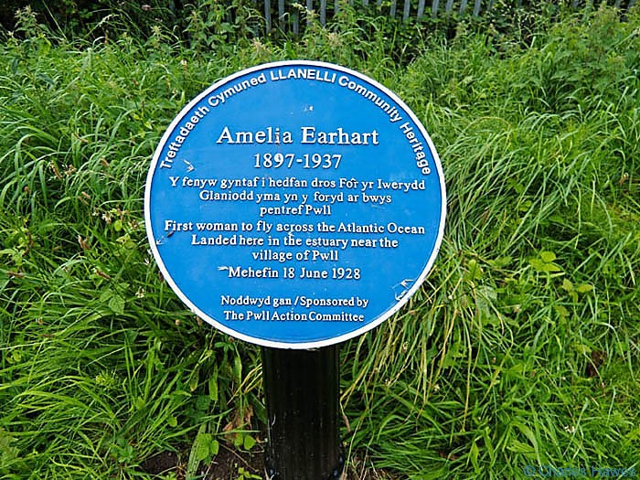 Plaque commemorating Amelia Earhart photographed on The Wales Coast path between Llanelli and Kidwelly by Charles Hawes. Walking in Wales.