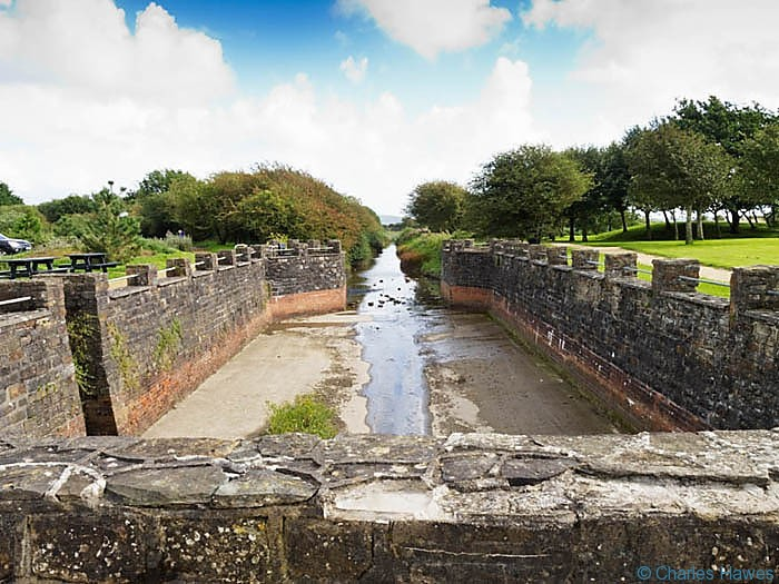 Dock at the end of Camlas Keymer canal photographed on The Wales Coast path between Llanelli and Kidwelly by Charles Hawes. Walking in Wales.