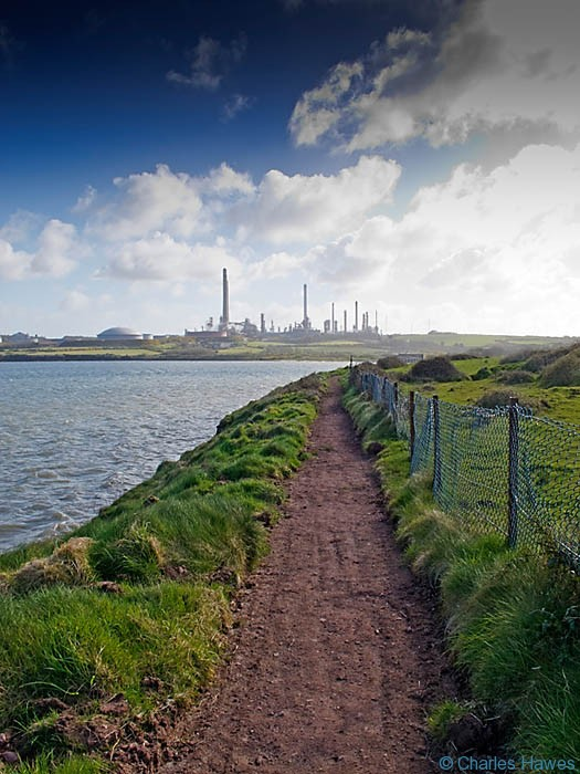 View of the oil refinery on Angle Bay, Pembrokeshire from the Wales Coast Path, photographed by Charles Hawes