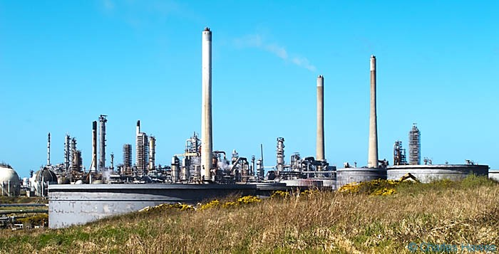 Oil refinery on Angle Bay, Pembrokshire, seen from The Wales Coast Path and photographed by Charles Hawes