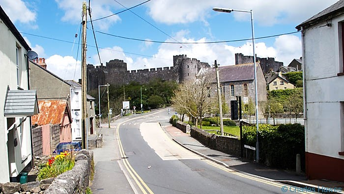 Approaching Pembroke Castle from Monkton on The Wales Coast Path, photographed by Charles Hawes