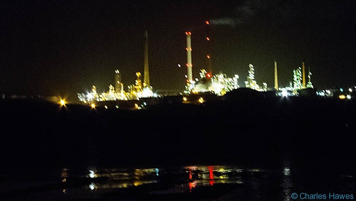 The oil refinery at night on Angle Bay, Pembrokeshire, photographed by Charles Hawes.