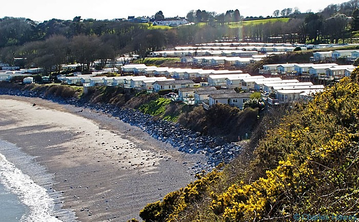 View of the Caravan Park at Lydstep Bay Pembrokeshire from the Wales Coast Path. Image by Charles Hawes.