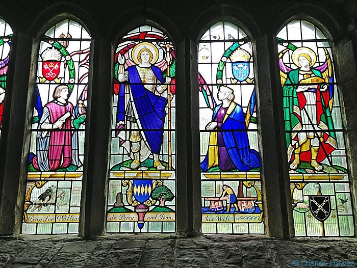 Stained glass window inside the  Norman St Michael and All Angels Church at Hubberholme, on The Dales Way, photographed by Charles Hawes.