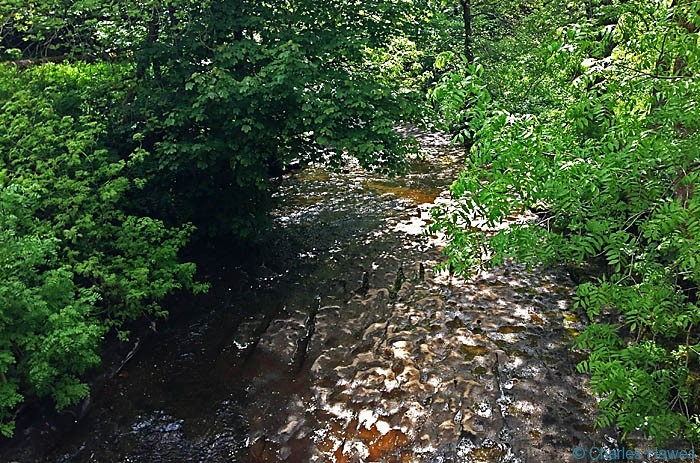 The limestone bed of the River Dee near Stone House on The Dales Way, photographed by Charles Hawes