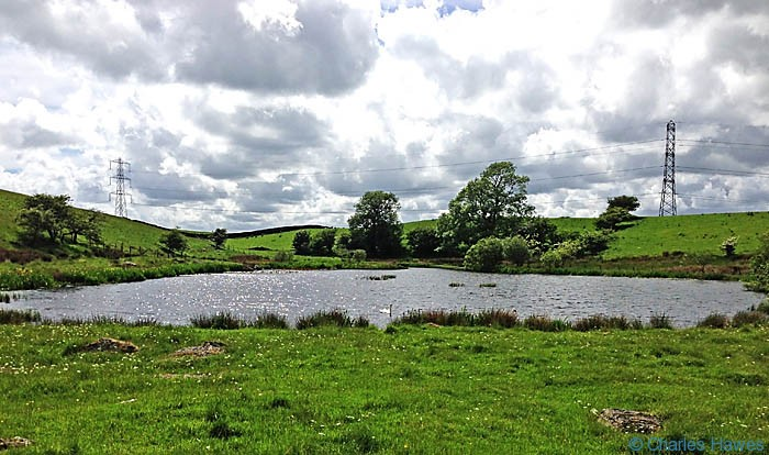 Black Moss tarn photographed from The Dales Way by Charles Hawes