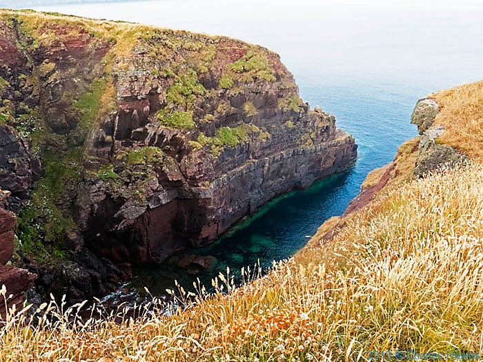 Deep inlet of the coast near Marloes, photographed on The Wales Cast Path in Pembrokeshire by Charles Hawes