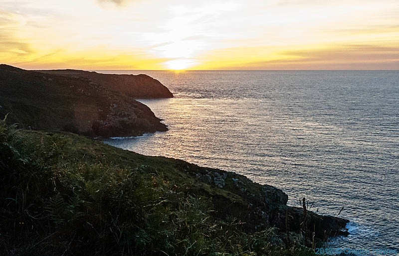 Sunset over The Irish Sea photographed  from the Wales Coast Path by Charles Hawes