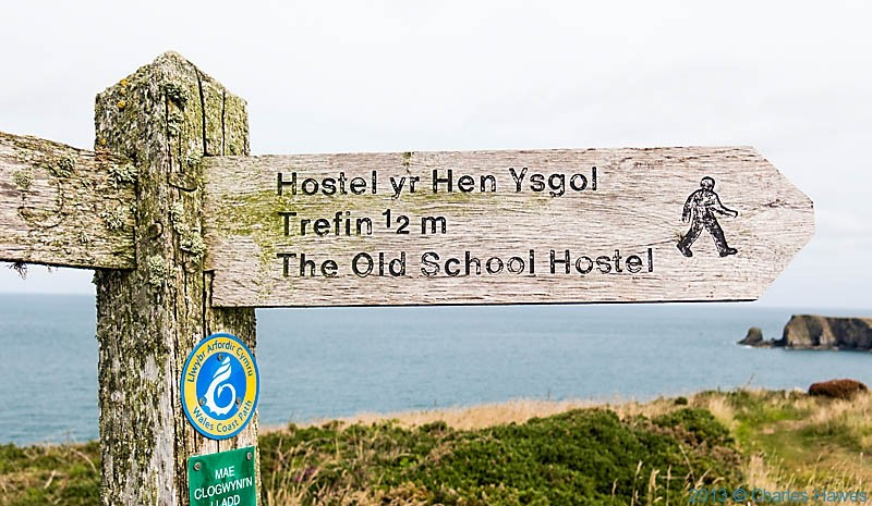 Finger post for the Old School Hostel, near Trefin, Pembrolkeshire, photographed from The Wales Coast path by Charles Hawes