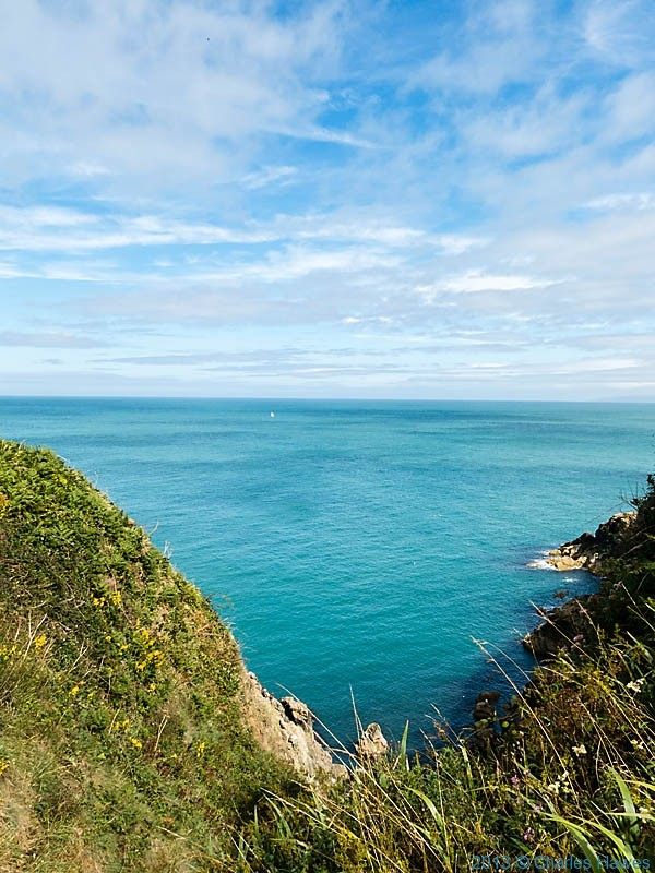 View to the sea from near Pen Caer, photographed from The Wales Coast path by Charles Hawes