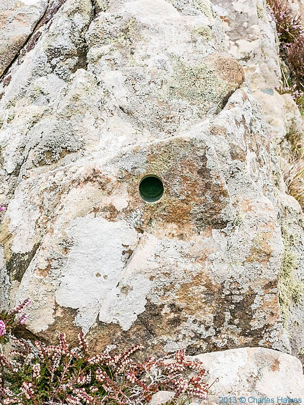 Drilled rock near Carn Melyn, Pembrokeshire, photographed from The Wales Coast path by Charles Hawes