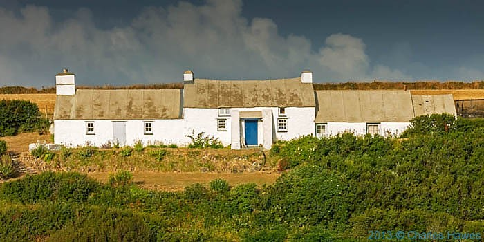 Cottage above Porhclais, Pembrokeshire, photographed from The Wales Coast Path by Charles Hawes