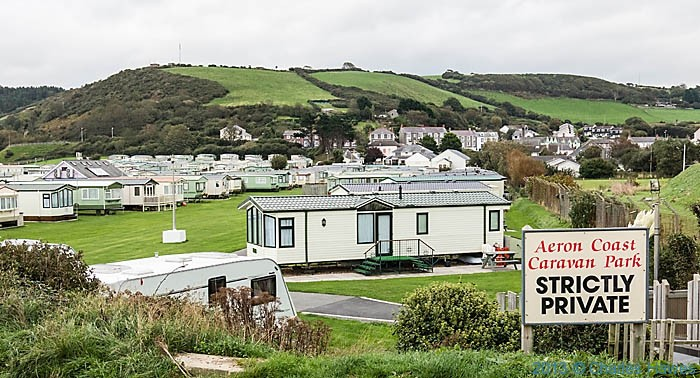 Caravan park outside Aberaeron, photographed from The wales Coast path in Ceredigion by Charles Hawes