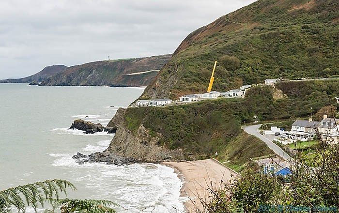 Beach and caravan site at Tresaith, Ceredigion, photographed from the Wales Coast Path by Charles Hawes
