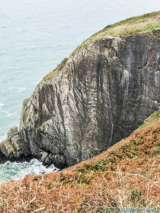 Conorted rock strata near Mwnt, Ceredigion, photographed from The Wales Coast Path by Chgarles Hawes