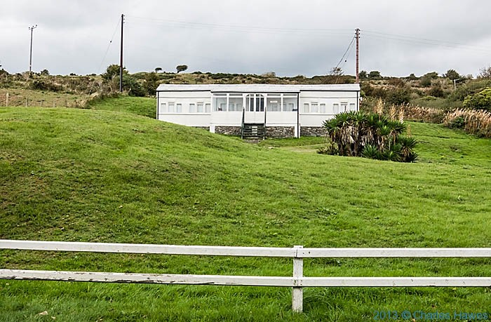 converted railway carriage between Gwbert and Cardigan photographed from The Wales Coast Path by Charles Hawes