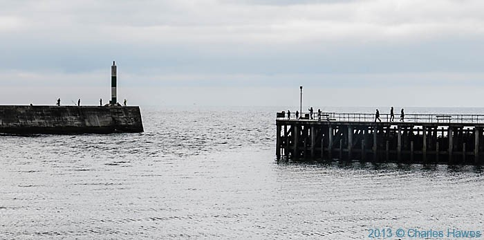 Harbour wall at Aberystwyth, photographed from The Wales Coast Path by Charles Hawes