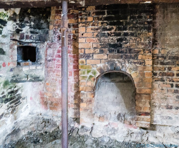 Fireplace with bread oven at Ffos-Las, Ceredigion, photographed by Charles Hawes