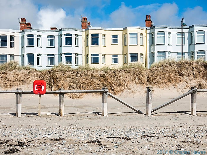Victorian terrace at the ddge of Pwllheli, photographed from The Wales Coast path by Charles Hawes