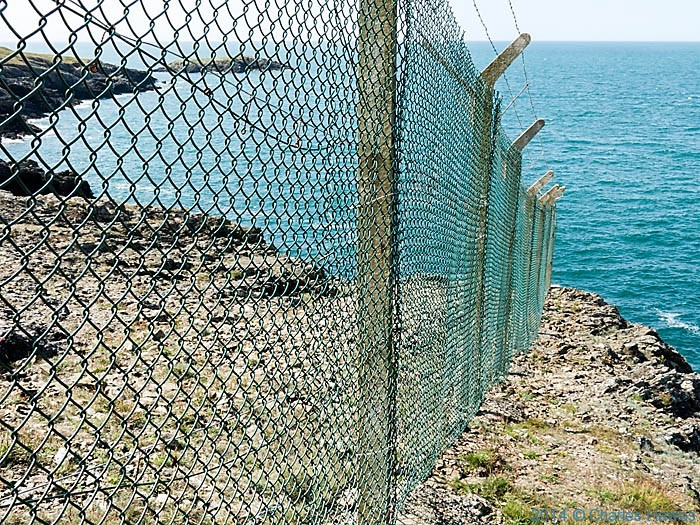 Fence across the coast near the Anglesey Motor Racing Circuit, photographed by Charles Hawes