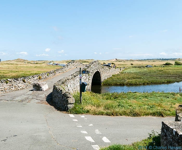 Packhorse bridge at Aberffraw, Anglesey, photographed from The wales Coast Path by Charles Hawes