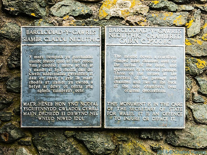 Sign at  Barclodiad y Gawres, Anglesey, photographed from The Wales Coast Path by Charles Hawes