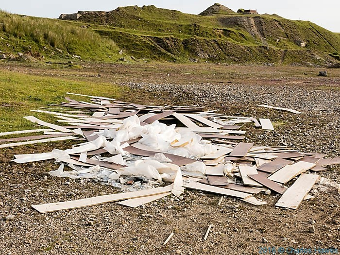 Waste dumped in the Cwar yr Hendre quarry, Brecon Beacons, photographed from The Cambrian Way by Charles Hawes.