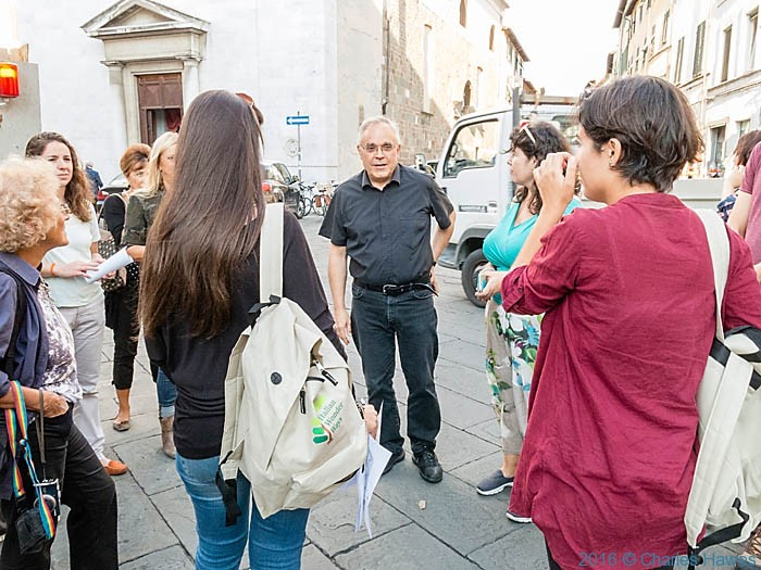Priest with pilgrims from IWW trip in Lucca, photographed by Charles Hawes
