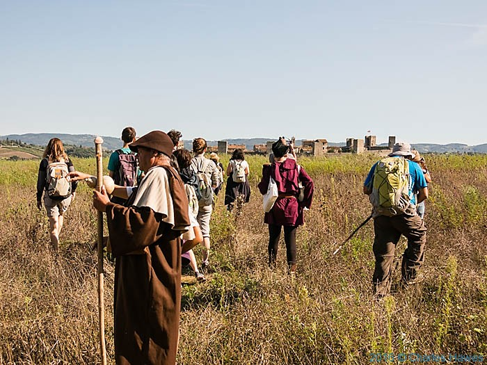 IWW participants on the Via Francigena near Monteriggioni, Tuscany, photographed by Charles Hawes